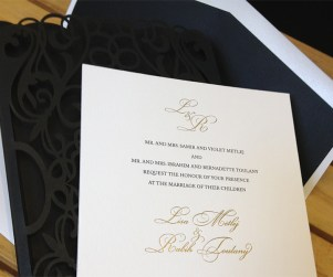 Custom chantilli lace laser cut invitation gold foil and letterpress showing invitation.