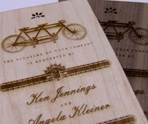 Maple and Walnut laser cut and engraved wedding invitations close up