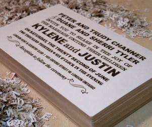 Stack of Fontography design laser cut wedding invitations