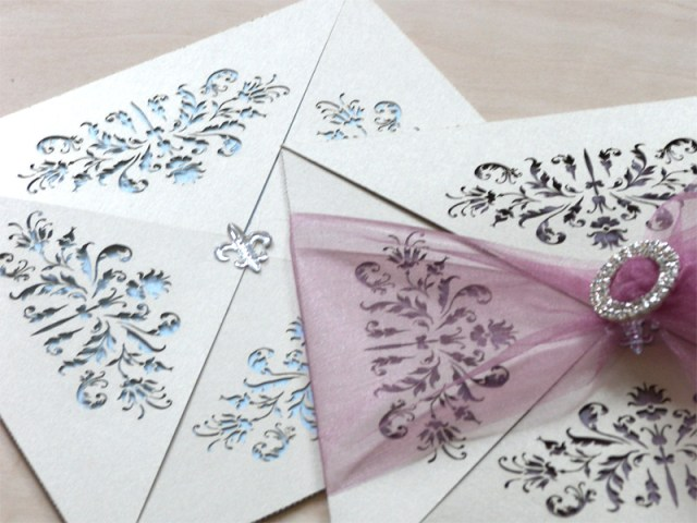 Couture invitations feature a delicate laser cut French pattern - blue