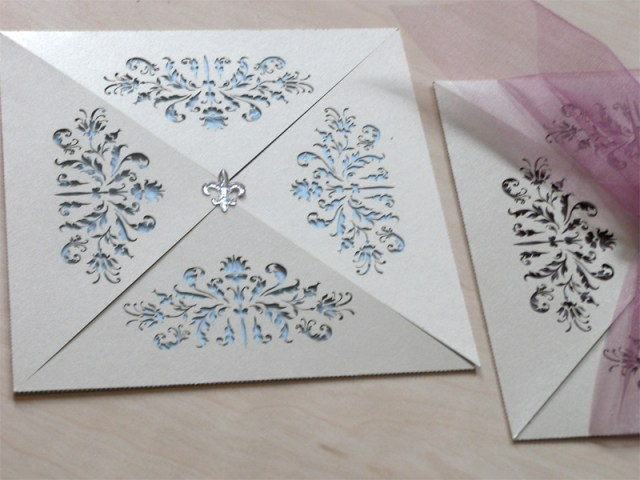 Couture invitations feature a delicate laser cut French pattern 1