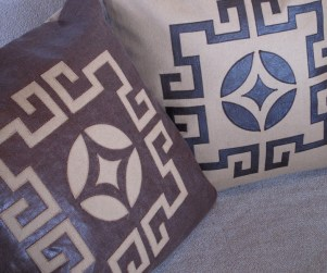 Laser cut throw pillows in camel and brown