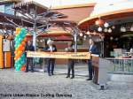 RIBBON CUTTING SIGNIFIES TOM S URBAN IS OPEN AT NEW YORK NEW YORK