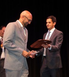 Qusair Mohamedbhai, (left) presented his award by Arash Jananian, Attorney at Law