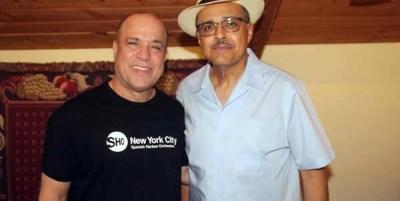Spanish Harlem Orchestra band leader Oscar Hernandez (left) with KUVO Radio General Manager Carlos Lando