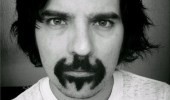 A picture of a guy with a mustache in the shape of a Batman symbol.