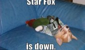 A dog lying on a couch wearing a Fox McCloud costume from Nintendo. Star Fox is down.