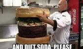 A chef building a giant hamburger.