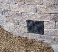 Retaining wall drainage pipe options? | LawnSite