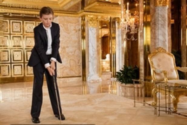 ابنهما بارون 9 سنوات يعشق لعبة الجولف