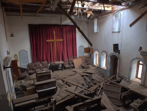 Photo, taken from  from the balcony of the Presbyterian Church in Homs, Syria, after it sustained a rocket or mortar attack.