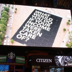 """Billboard that says """"What would you do if your income were taken care of?"""""""