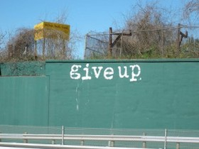 """Give Up"" written in graffiti"