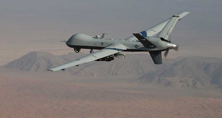 An MQ-9 Reaper, armed with GBU-12 Paveway II laser guided munitions and AGM-114 Hellfire missiles, piloted by Col. Lex Turner flies a combat mission over southern Afghanistan