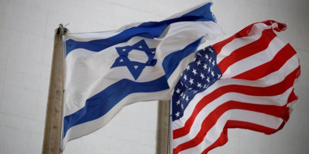 The American and the Israeli national flags can be seen outside the U.S Embassy in Tel Aviv, Israel December 5, 2017. REUTERS/Amir Cohen