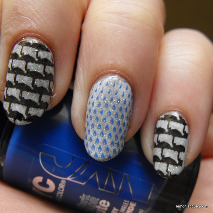 closeup on three fingers of rainy day nail stamping