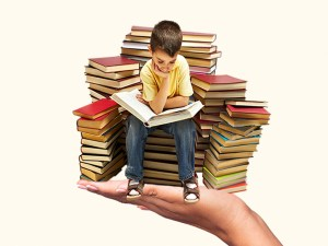 Boy Reading Book on a Stack of Books