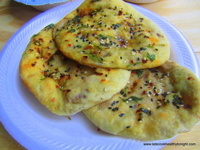 Stuffed Kulchas seasoned with herbs,seasame and olive oil