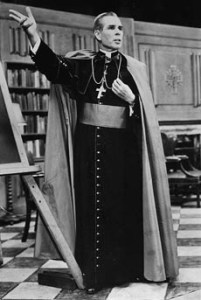 Fulton Sheen on the set of Life is Worth Living. Bishop Sheen appeared in full regalia, surrounded by books. He made ample use of a blackboard to make his points.