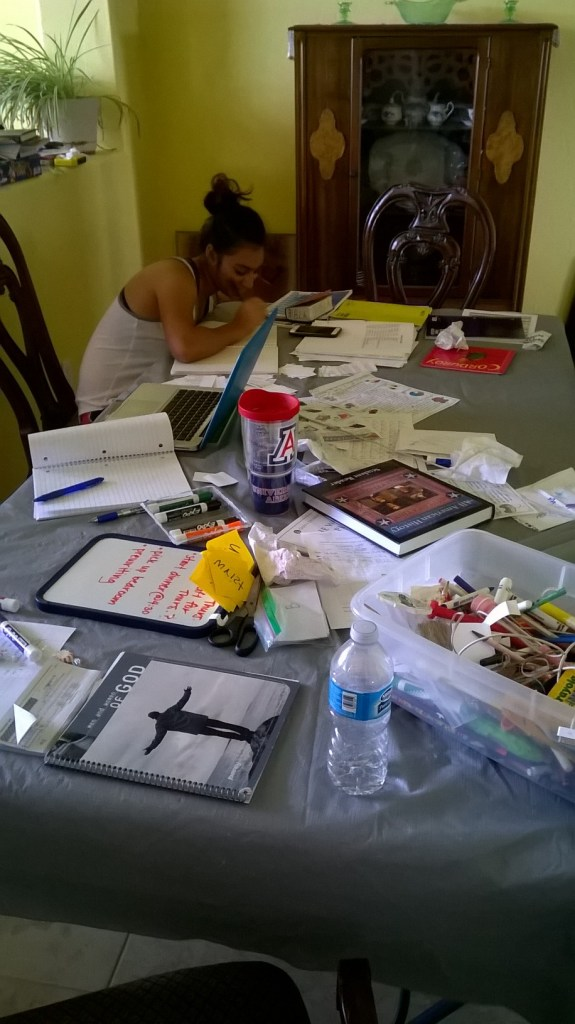 The messy table and the studying sister that I hang out with all day : )