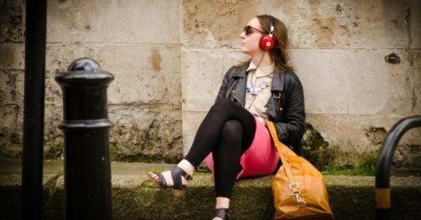 Listening to music while waiting for a friend.