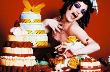 Pin-Up Model Messily Eating Cakes