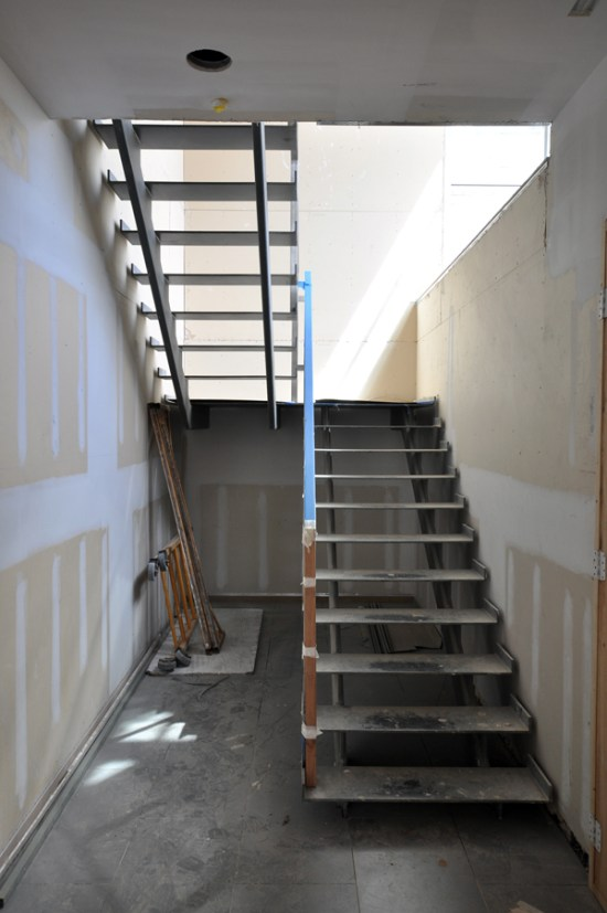 modern steel stairs - stainless steel handrail construction begins