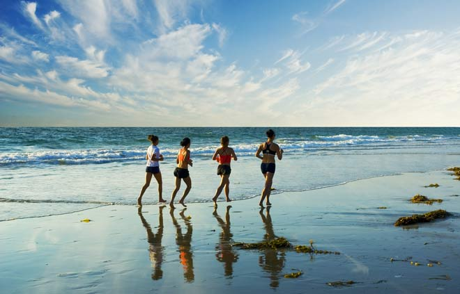 fitness - running, jogging on the beach