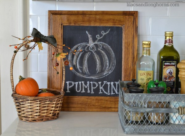 pumpkins and chalk board
