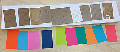 Planning the placement and colors of cutout letters on a sign