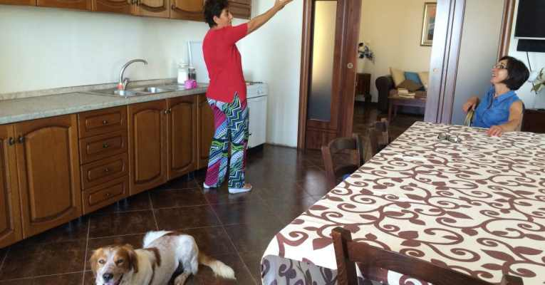 cousins talking in the kitchen