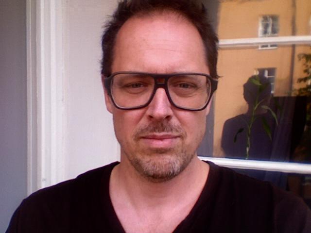 Nikke Lindqvist on the balcony