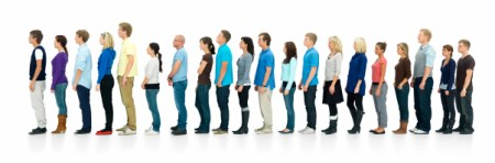 Long line of people standing in queue