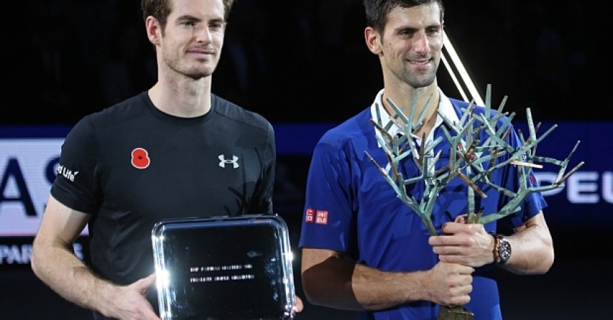 Image : 40696597    Andy Murray (L) of Great Britain and Novak Djokovic of Serbia hold their respective trophies after their finals match at the BNP Paribas Masters in Paris on November 8, 2015. Djokovic defeated Murray 6-2, 6-4 to win his fourth Masters title in Paris.    PHOTOGRAPH BY UPI /Landov / Barcroft Media  UK Office, London. T +44 845 370 2233 W www.barcroftmedia.com  USA Office, New York City. T +1 212 796 2458 W www.barcroftusa.com  Indian Office, Delhi. T +91 11 4053 2429 W www.barcroftindia.com
