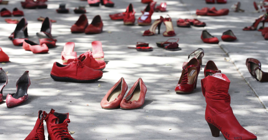 Red women's shoes are on display outside Mexico's consulate in El Paso in the U.S. July 27, 2012. Dozens of red shoes were put on display by visual artist Elina Chauvet in honor of the hundreds of women and girls who were killed in Ciudad Juarez. Long associated with crime and corrupt police, Ciudad Juarez has seen the murders of hundreds of women and girls since 1993. Despite international pressure to solve the murders, including support from writers, singers and Amnesty International, most cases remain mysteries. REUTERS/Jose Luis Gonzalez (UNITED STATES - Tags: CRIME LAW CIVIL UNREST SOCIETY)