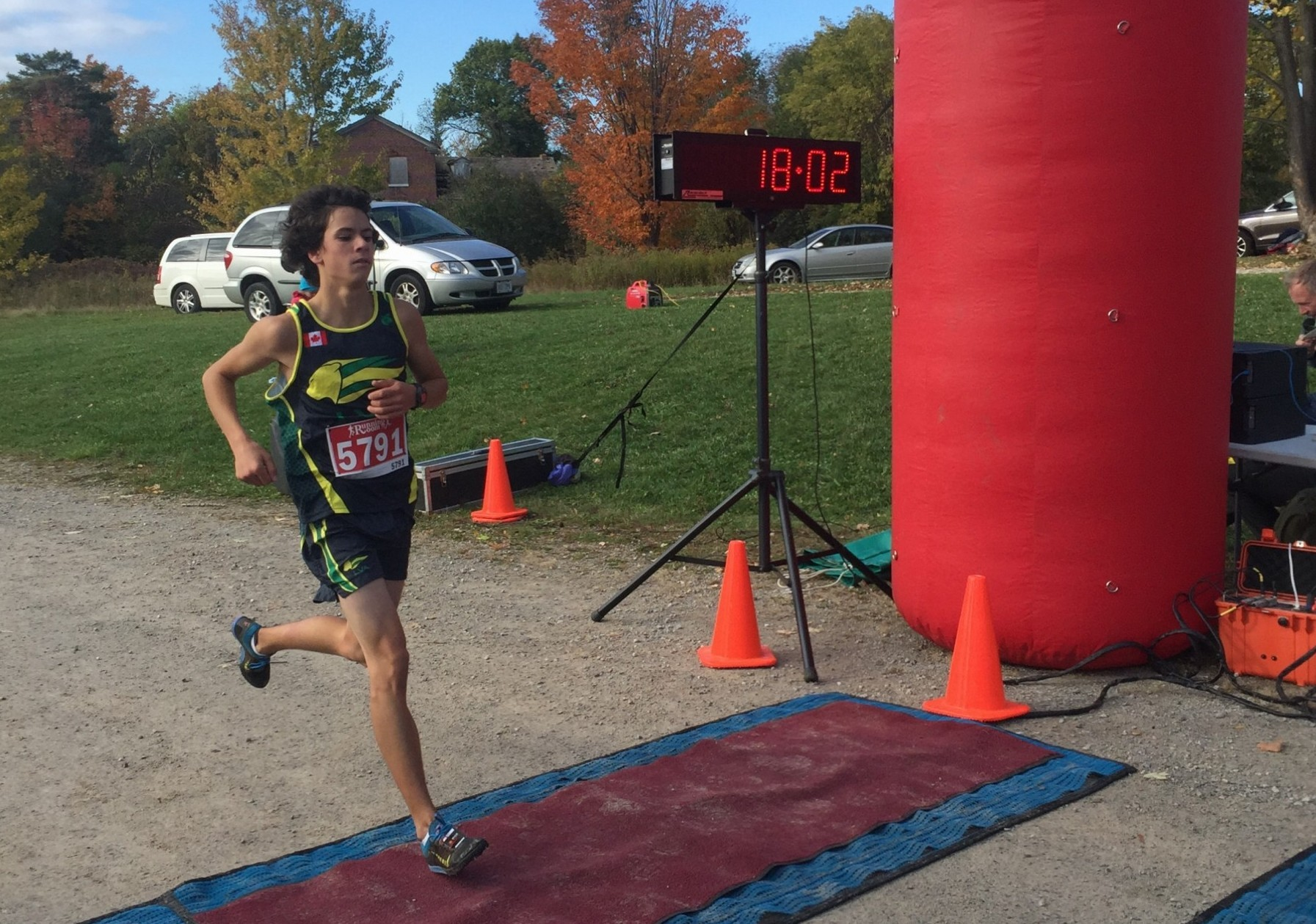 David Gallant crossing the finish 1st Overall in the Turkey Trot 5K