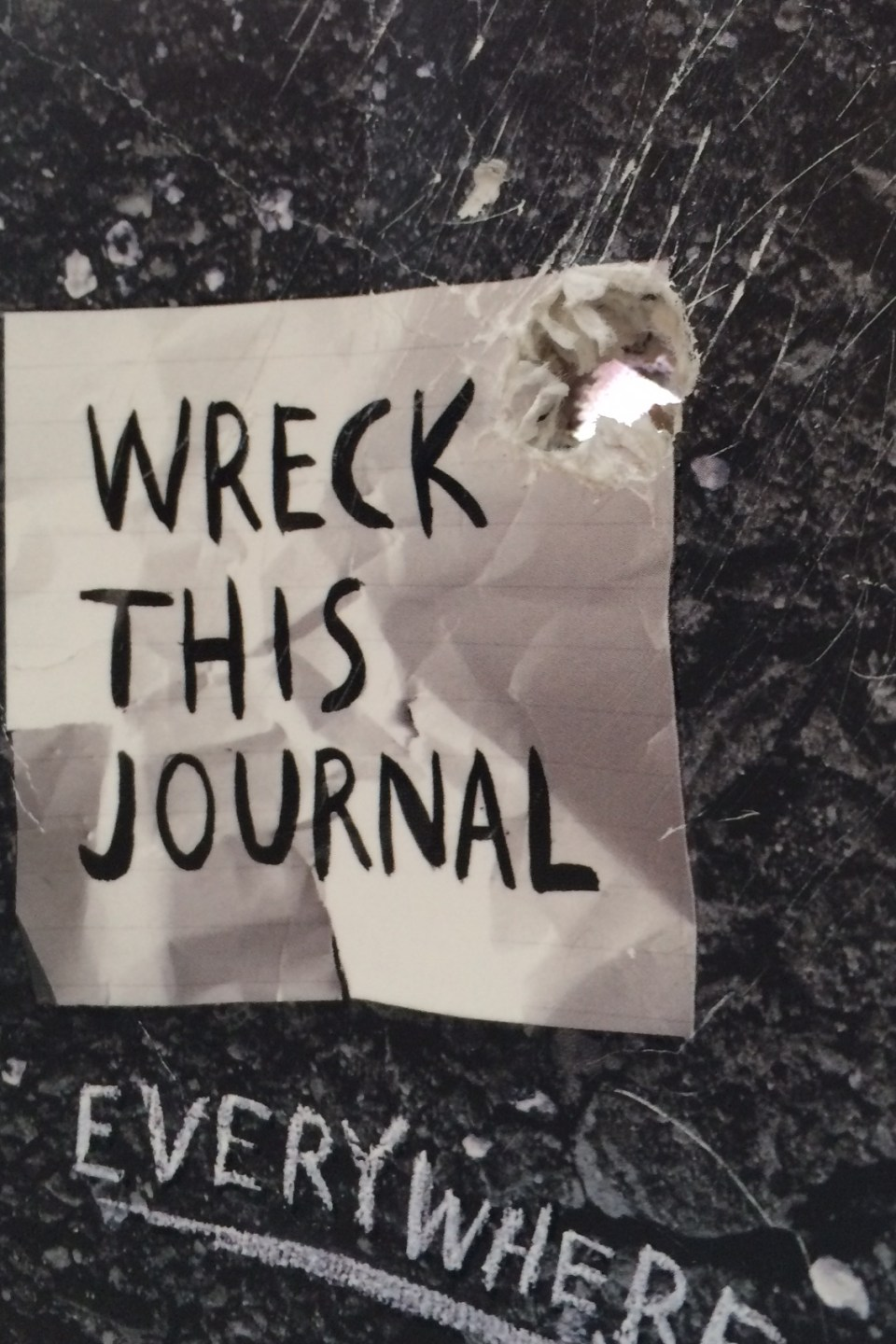 Hole-y wrecked journal, Batman!