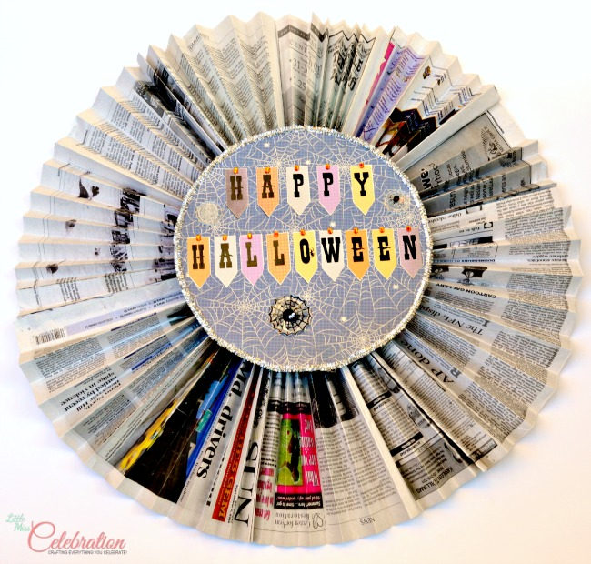 Make lots of Halloween decor on pennies! Easy Halloween Newspaper Rosettes at littlemisscelebration.com