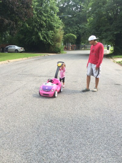 Such an independent girl now, she didn't want daddy's help pushing and she didn't want to sit in her car.