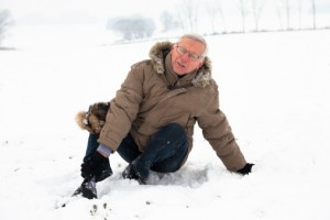 Older Man with Injured Leg in Snow