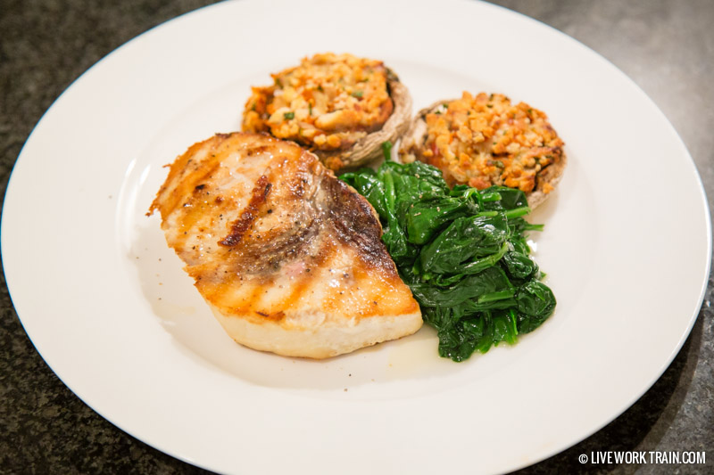 Swordfish steak with spinach and stuffed mushrooms