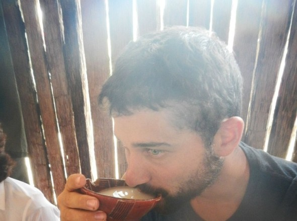 Josh-Rueff-drinking-chicha-a-tribal-yucca-drink-in-Ecuador-scaled
