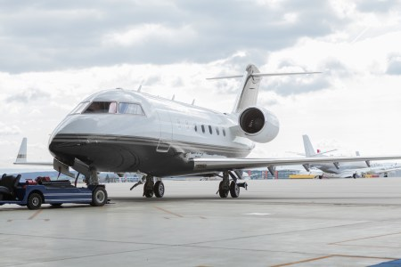 Aircraft learjet Plane in front of the Airport with cloudy sky