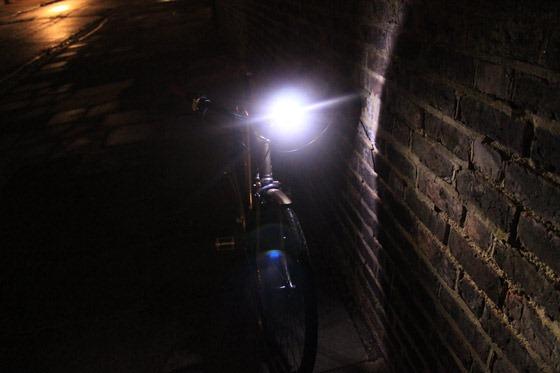 Blackburn flea light pointing towards brick wall at night