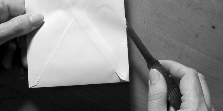 envelope and letter opener - opening mail
