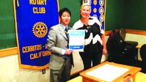 "Local Rotary Club Receives Special Honor By Larry Caballero CAPTION: The Rotary Club of Cerritos-Artesia was presented with a special banner at its regular meeting Feb 8 for having all of its members contribute at least $100 to the Rotary Foundation in 2014~2015. President Sug Kitahara accepts the honor from the Assistant Governor Lauren Pittman on behalf of the club. The Rotary Foundation transforms gifts into projects that change lives both close to home and around the world. As the charitable arm of Rotary, it taps into a global network of Rotarians who invest their time, money, and expertise into priorities, such as eradicating polio and promoting peace.  ""Foundation grants empower Rotarians to approach challenges such as poverty, illiteracy, and malnutrition with sustainable solutions that leave a lasting impact,"" said Kitahara."