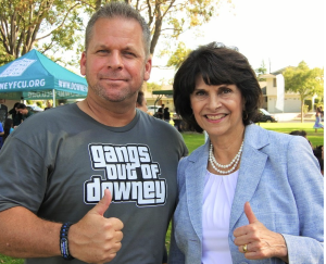 Congresswoman Lucille Roybal-Allard meets with Gangs Out of Downey President and Downey Police Lt. Mark McDaniel, who is wearing Gangs Out of Downey's new t-shirt and logo.