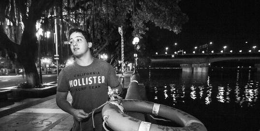 24-year-old Venezuelan, Carlos, near where he rescued a woman from a river in Guangzhou. Photo by Li Zhan