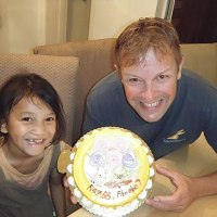 A 2013 photo of Ray Wigdal and Phoebe celebrating a birthday together. Photo source:  rayschildren.org.