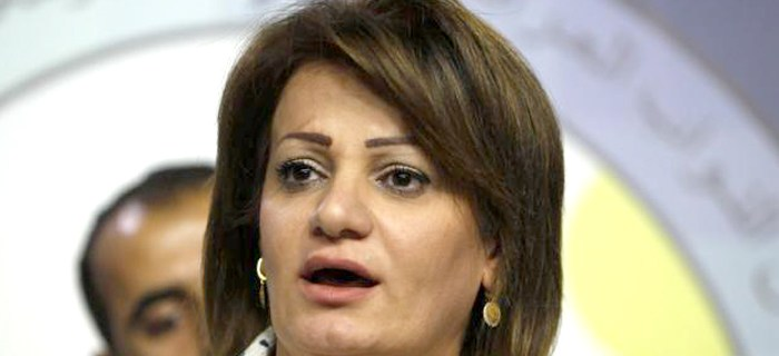 Lawmaker Srwa Abdulwahid, in a Kurdish coalition, speaks during a news conference in Baghdad, August 5, 2014. REUTERS/Ahmed Saad (IRAQ - Tags: POLITICS HEADSHOT)